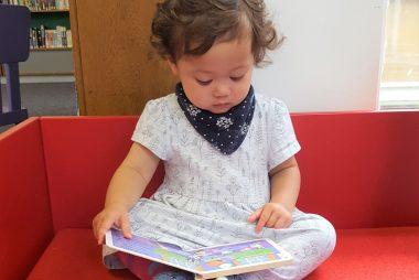 A young reader enjoys Peppa Pig